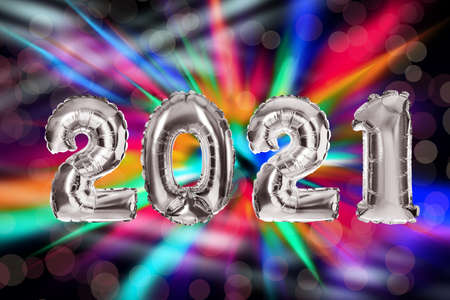 2021 New Year celebration. Creative design with bright balloons and blurred lights on color background