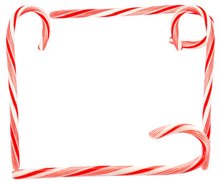 Frame of tasty Christmas candy canes on white background