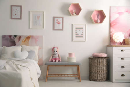 Stylish child's room interior with beautiful pictures and comfortable bed Stock fotó