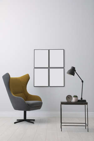 Stylish room interior with empty posters on wall. Mockup for design Standard-Bild
