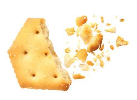 Crushed cracker and crumbs on white background