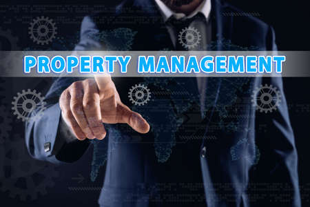 Property management concept. Man using virtual screen with gear images, closeup Stock fotó