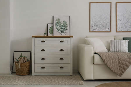 Modern chest of drawers in living room. Interior design