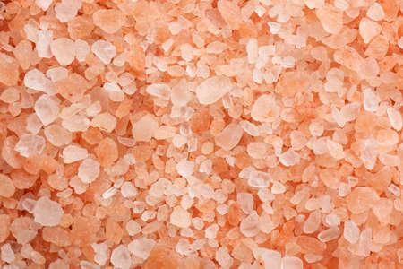 Pink himalayan salt as background, top view Banco de Imagens