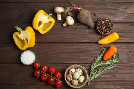 Frame of ingredients for cooking on wooden table, flat lay. Space for text Stock fotó
