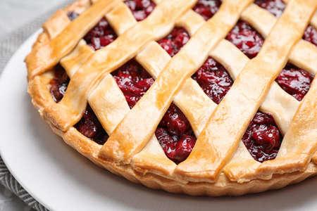 Delicious fresh cherry pie on tray, closeup