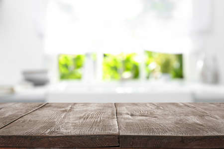 Wooden table in light kitchen. Space for design