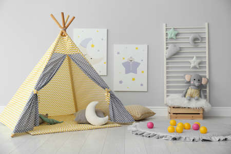 Stylish child's room interior with adorable paintings and play tent