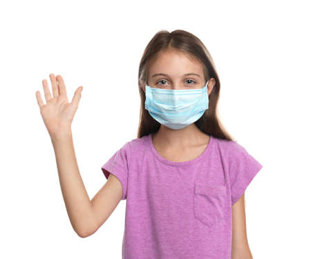 Little girl in protective mask showing hello gesture on white background. Keeping social distance during coronavirus pandemic Stock fotó - 155434858