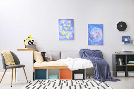 Modern teenager's room interior with comfortable bed and stylish design elements