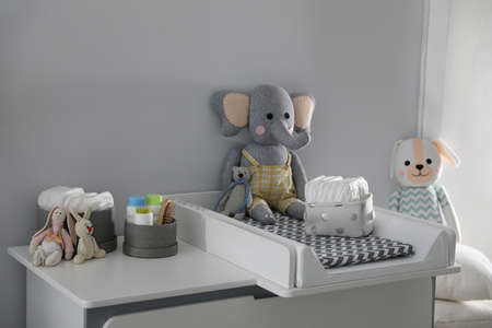 Modern changing table in baby room. Interior design