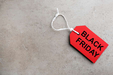 Top view of blank tag on light gray stone background, space for text. Black Friday concept Stock fotó