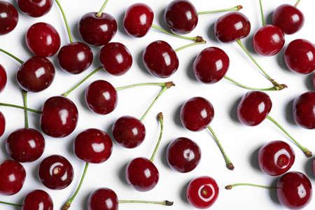 Sweet juicy cherries on white background, top view