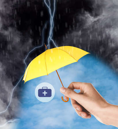Insurance agent protecting medical kit illustration with yellow umbrella from thunderstorm, closeup
