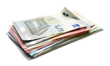 Pile of different Euro banknotes on white background