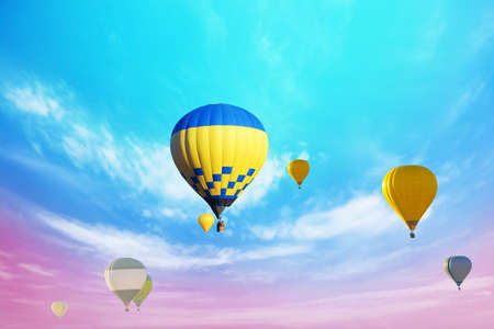 Fantastic dreams. Hot air balloons in bright sky with clouds