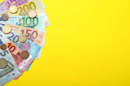 Money on yellow background, flat lay. Space for text Stock fotó