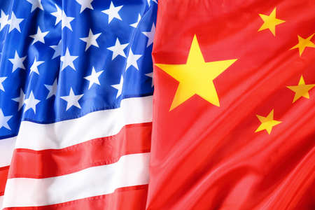 USA and China flags as background, top view. International relations Foto de archivo