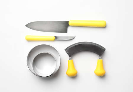 Set of modern cooking utensils on white background, top view