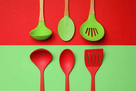Set of modern cooking utensils on color background, flat lay