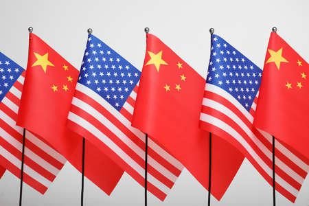 USA and China flags on white background. International relations