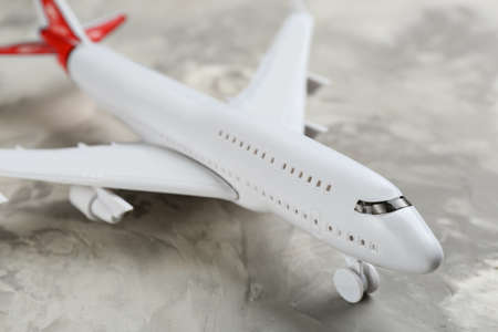 Toy airplane on gray background, closeup view