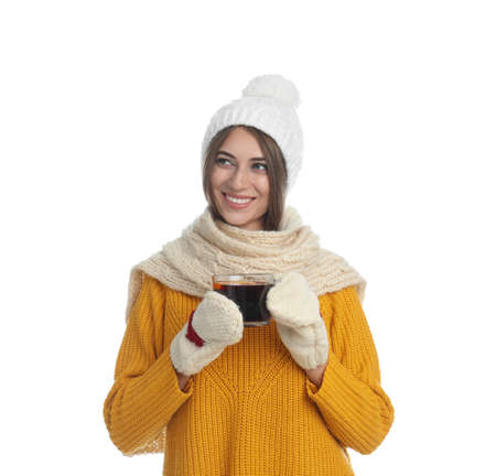 Happy beautiful woman with cup of mulled wine on white background Foto de archivo