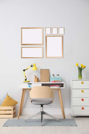 Stylish room interior with empty posters on wall. Mockup for design