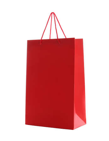 Red paper shopping bag isolated on white Foto de archivo