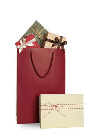 Paper shopping bag and gift boxes isolated on white Imagens