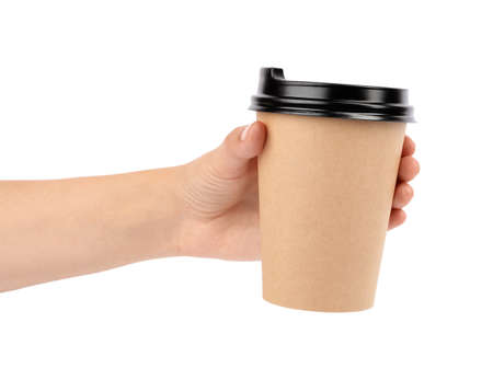 Woman holding takeaway paper coffee cup on white background, closeup