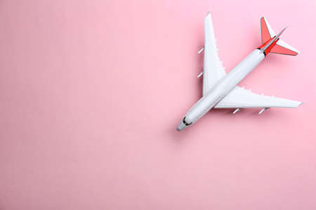Toy airplane on pink background, top view. Space for text Stock Photo