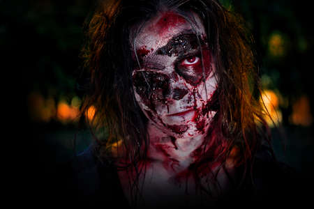 Scary zombie on dark background. Halloween monster