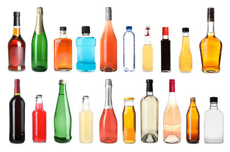 Set of bottles with different liquids on white background Banco de Imagens