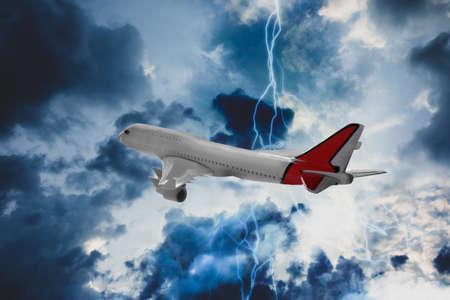 Airplane flying in cloudy sky during thunderstorm