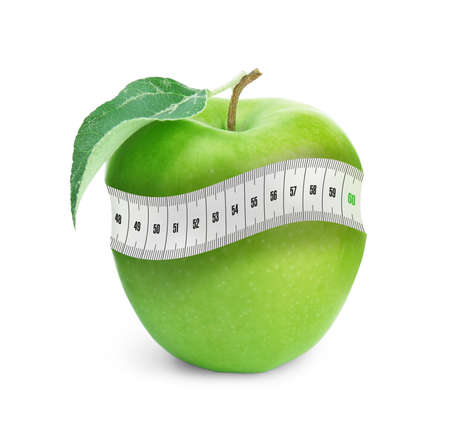 Green apple with measuring tape on white background. Slimming, weight loss concept Archivio Fotografico