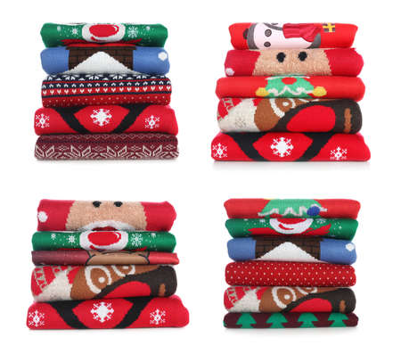 Set with stacks of folded Christmas sweaters on white background
