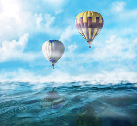 Dream world. Hot air balloons in sky with clouds over misty sea