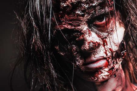 Scary zombie on dark background, closeup. Halloween monster Фото со стока