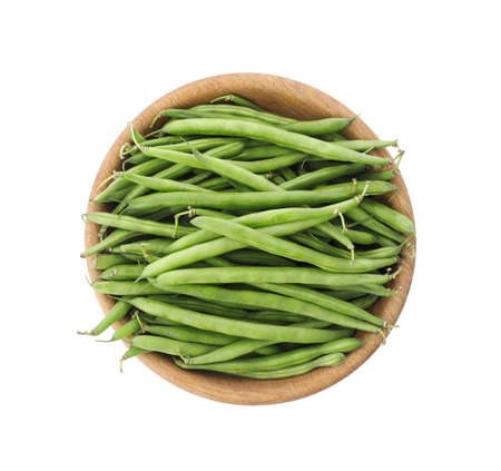 Fresh green beans in wooden bowl isolated on white, top view
