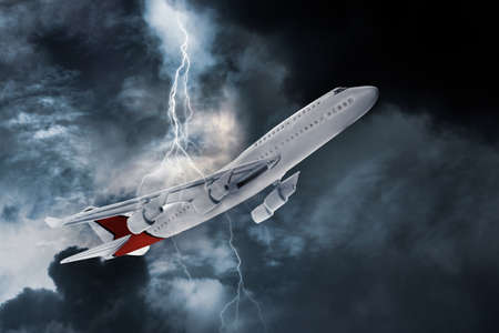Airplane flying in cloudy sky during thunderstorm Banque d'images