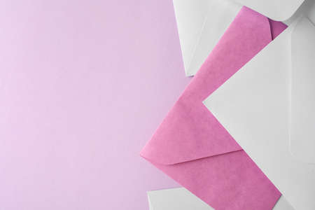 Colorful paper envelopes on pink background, flat lay. Space for text Stock fotó