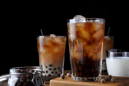 Tasty milk bubble tea on wooden table, closeup Stock fotó