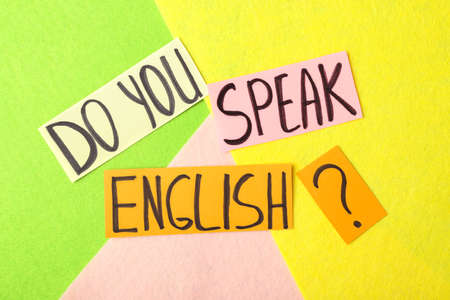 Question DO YOU SPEAK ENGLISH? on color background, flat lay