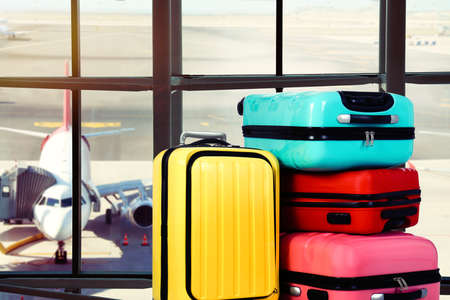 Travel suitcases in airport terminal. Summer vacation
