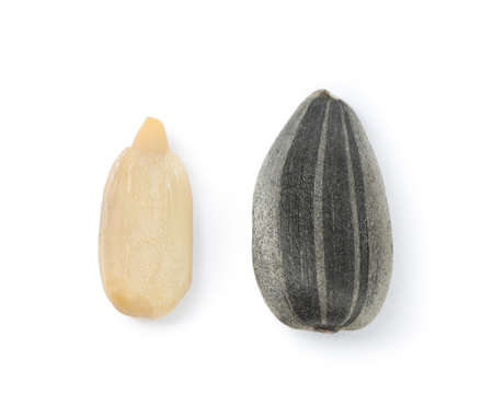 Raw peeled and unpeeled sunflower seed isolated on white, top view 스톡 콘텐츠