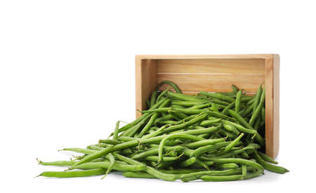 Fresh green beans and wooden crate on white background