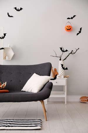 Stylish room interior with creative Halloween decor