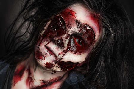 Scary zombie on dark background, closeup. Halloween monster Stock Photo