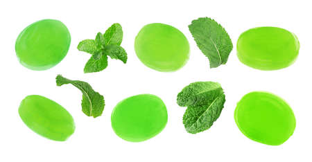 Set of mint hard candies and green leaves on white background. Banner design